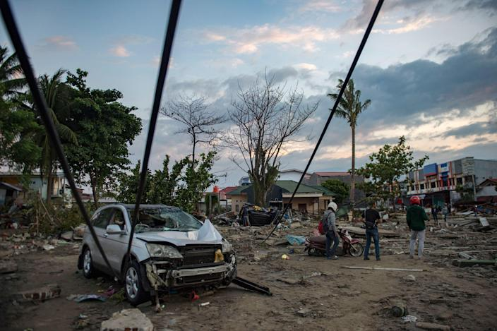 <p>People view the damage to a beach hit by a tsunami in Palu in Central Sulawesi on Sept. 29, 2018, after a strong earthquake and tsunami struck the area. (Photo: Bay Ismoyo/AFP/Getty Images) </p>