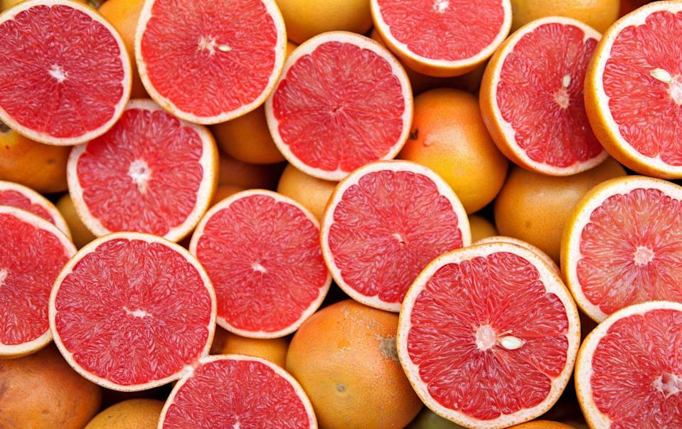 """<p>Like other citrus, grapefruit packs tons of vitamin C. <a href=""""https://www.ncbi.nlm.nih.gov/pubmed/22304836"""" rel=""""nofollow noopener"""" target=""""_blank"""" data-ylk=""""slk:Research"""" class=""""link rapid-noclick-resp"""">Research</a> has shown that consuming grapefruit improves blood pressure and may help to lower cholesterol levels. Make it easy to get those citrusy sections with a grapefruit knife and add them to salad, yogurt, granola or oatmeal. </p><p><strong>RELATED: </strong><a href=""""https://www.goodhousekeeping.com/health/diet-nutrition/g4840/how-to-lower-cholesterol/"""" rel=""""nofollow noopener"""" target=""""_blank"""" data-ylk=""""slk:35 Foods That Can Help Lower Your Cholesterol"""" class=""""link rapid-noclick-resp"""">35 Foods That Can Help Lower Your Cholesterol</a></p>"""