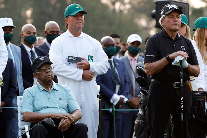 Wayne Player holds a sleeve of golf balls near Lee Elder during the ceremonial tee shots of the Masters. (Mike Segar/Reuters)