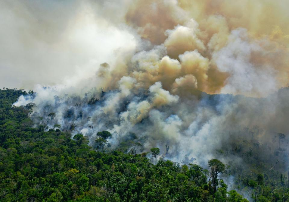 TOPSHOT - Aerial view of a burning area of Amazon rainforest reserve, south of Novo Progresso in Para state, on August 16, 2020. (Photo by CARL DE SOUZA / AFP) (Photo by CARL DE SOUZA/AFP via Getty Images)