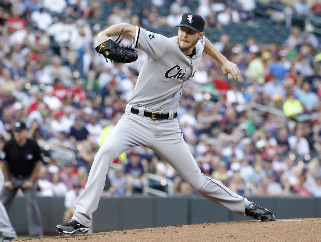 Chicago White Sox starting pitcher Chris Sale delivers to the Minnesota Twins during the first inning of a baseball game in Minneapolis, Saturday, July 26, 2014. (AP Photo/Ann Heisenfelt)