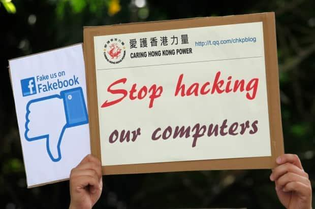 Revelations by Edward Snowden about NSA hacking triggered protests including this one from a pro-China party in Hong Kong in 2013. By 2017, the NSA's hacking tools were stolen and dumped online for use by criminals and other nations.