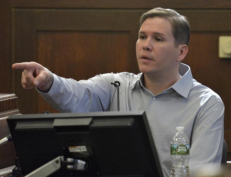 Tattoo artist David Nelson points to Former New England Patriots football player Aaron Hernandez, when asked to identify him in the courtroom during Hernandez's double murder trial in Suffolk Superior Court in Boston on Friday, March 17, 2017. Hernandez is on trial for the July 2012 killings of Daniel de Abreu and Safiro Furtado who he encountered in a Boston nightclub. The former NFL player is already serving a life sentence in the 2013 killing of semi-professional football player Odin Lloyd. (Chris Christo/The Boston Herald via AP, Pool)