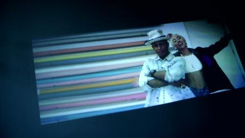 Screen showing Keecker projection of music video