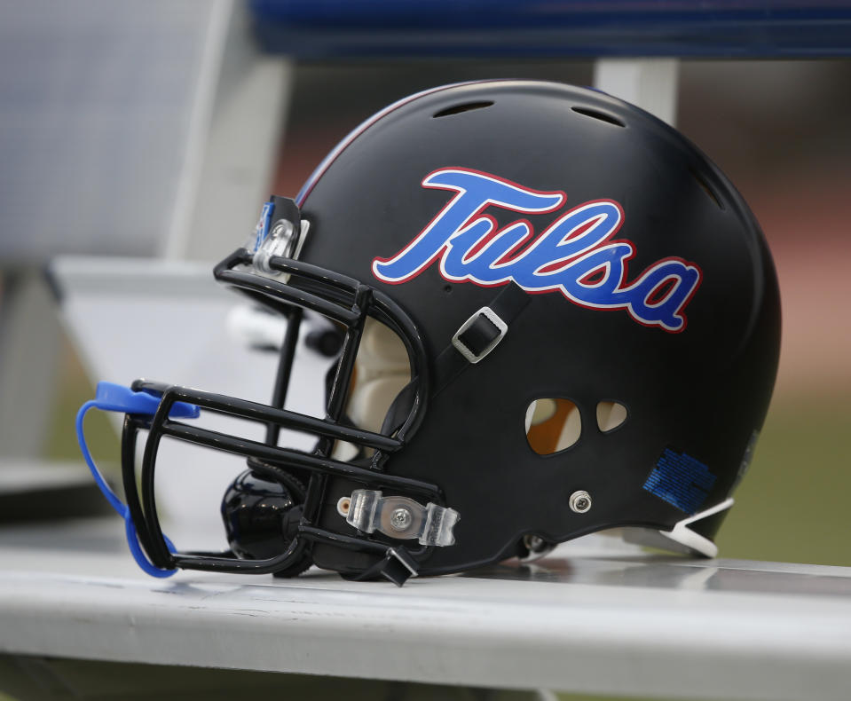 A Tulsa football helmet sits on the team bench before an NCAA college football game.