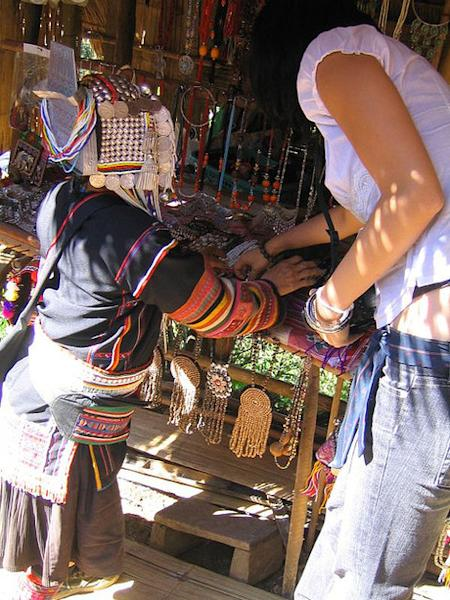 Bartering for jewelry in a market in Thailand. (Photo courtesy of flickr.com/photos/moniquz.)