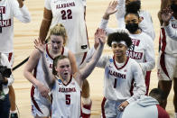Alabama guard Hannah Barber (5) and guard Megan Abrams (1) celebrate after a college basketball game against North Carolina in the first round of the women's NCAA tournament at the Alamodome in San Antonio, Monday, March 22, 2021. Alabama won 80-71. (AP Photo/Eric Gay)