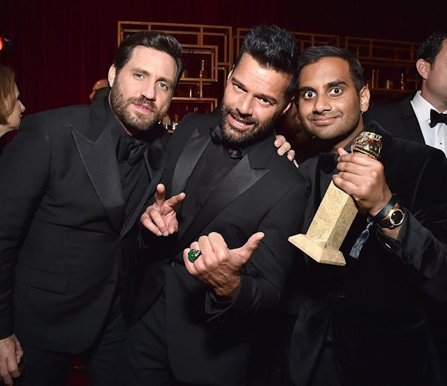 <p>Edgar Ramirez, Ricky Martin, and Aziz Ansari attend the Netflix Golden Globes party. (Photo: Kevin Mazur/Getty Images for Netflix) </p>