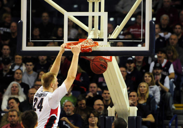 Gonzaga's Przemek Karnowski (24) dunks against Bryant in the first half of an NCAA college basketball game on Saturday, Nov. 9, 2013, in Spokane, Wash. (AP Photo/Jed Conklin)