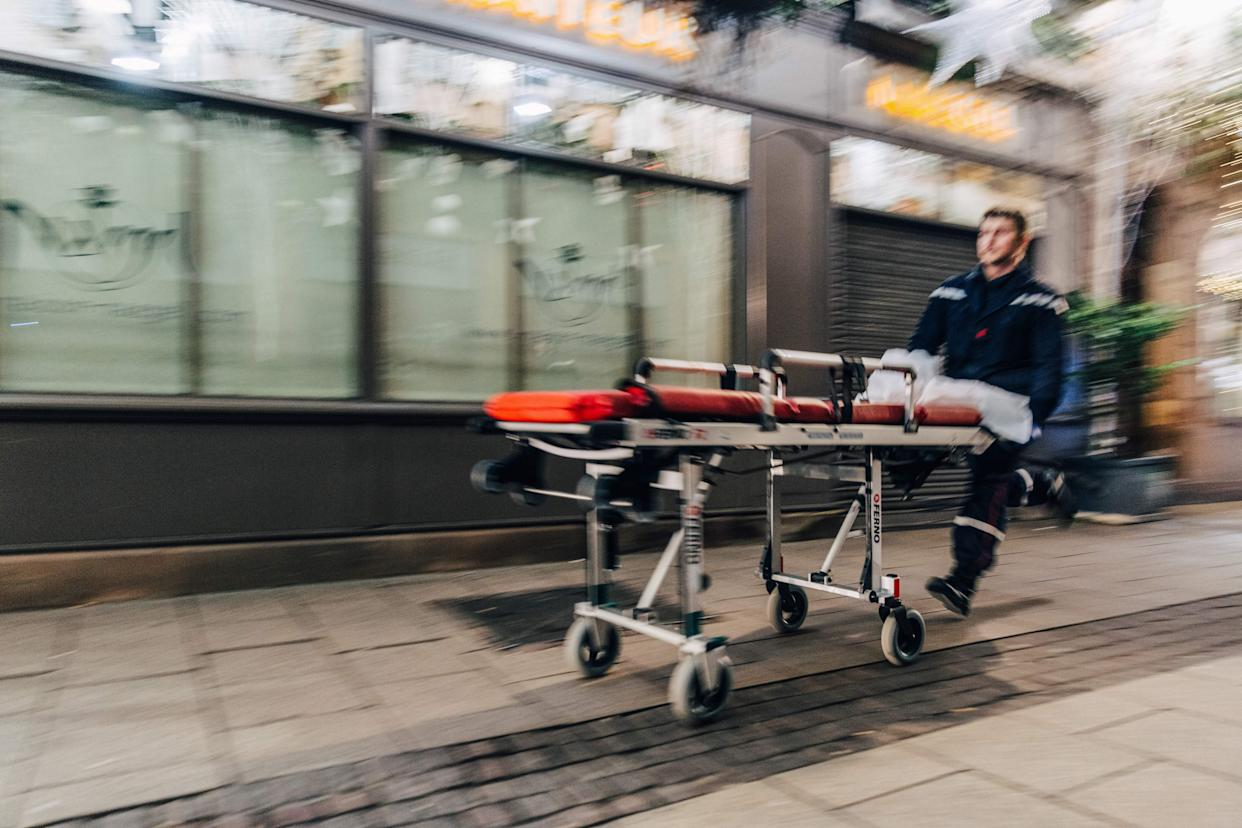 An emergency worker runs with a stretcher towards the scene of a shooting near the Christmas market in Strasbourg, eastern France, on Dec. 11, 2018. (Photo: Abdesslam Mirdass/AFP/Getty Images)