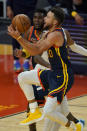 Golden State Warriors guard Stephen Curry shoots against the Minnesota Timberwolves during the first half of an NBA basketball game in San Francisco, Monday, Jan. 25, 2021. (AP Photo/Jeff Chiu)