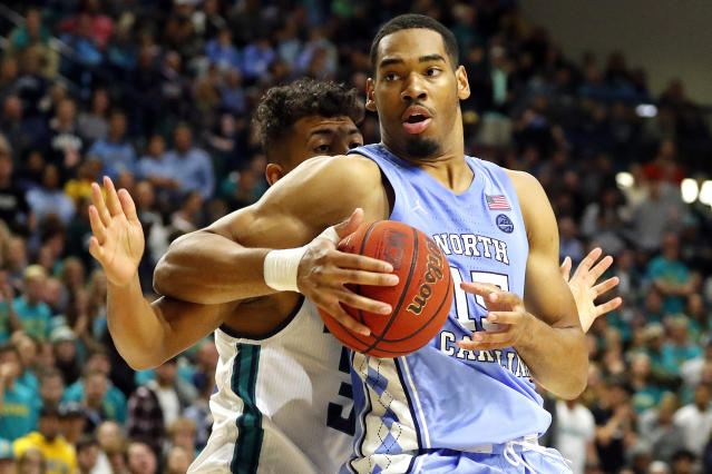 North Carolina's Garrison Brooks (15) battles for the ball with UNC Wilmington 's John Bowen (32) during the first half of an NCAA college basketball game in Wilmington, N.C., Friday, Nov. 8, 2019. (AP Photo/Karl B DeBlaker)