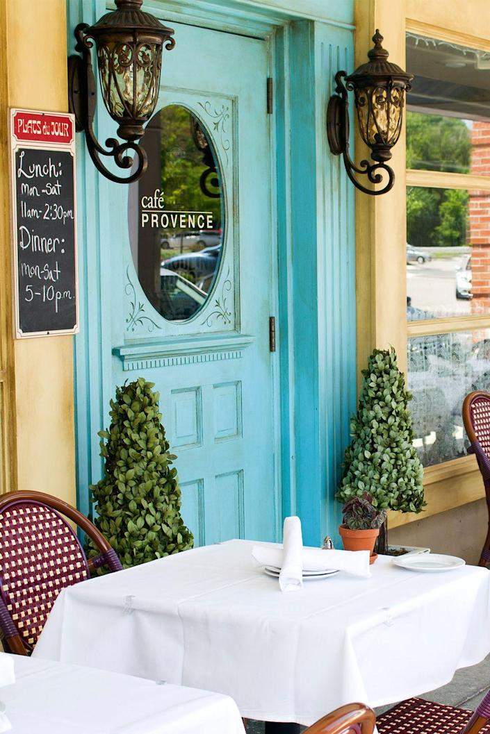 """<p><strong>Prairie Village, Kansas</strong></p><p>There's no need to fly to Paris when you have <strong><a href=""""https://www.cafeprovencekc.com/"""" rel=""""nofollow noopener"""" target=""""_blank"""" data-ylk=""""slk:Café Provence"""" class=""""link rapid-noclick-resp"""">Café Provence</a></strong> nearby. With a decadent cheese variety and all the French classics, you're bound to enjoy a beautiful meal with your partner at this spot. Polish off your dinner with an authentic crêpe or pot de crème. </p>"""
