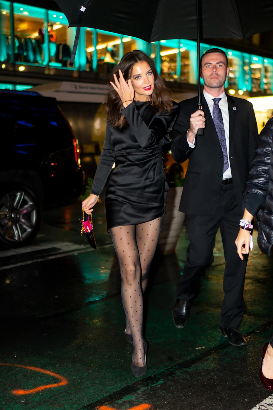 Katie Holmes proved patterned tights were the perfect LBD partner in this Saint Laurent ensemble. <em>[Photo: Getty]</em>