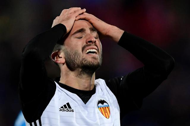 Valencia defender Jose Luis Gaya Pena reacts after missing a goal opportunity during the Spanish league football match Getafe CF vs Valencia CF at the Col. Alfonso Perez stadium in Getafe, Spain on December 3, 2017 (AFP Photo/JAVIER SORIANO)
