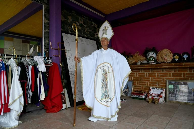 Mexican activist Julia Klug poses on August 8, 2019 in Mexico City wearing a pope-like outfit she wore to protest against the Catholic church