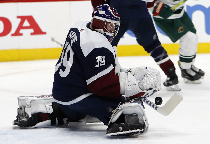 Colorado Avalanche goaltender Pavel Francouz makes a stick-save of a shot in the second period of an NHL hockey game against the Minnesota Wild, Friday, Dec. 27, 2019, in Denver. (AP Photo/David Zalubowski)