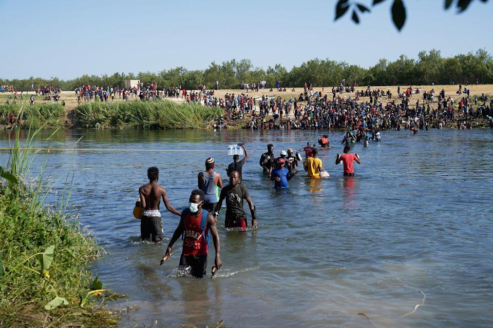 Thousands of migrants, many of them Haitian, illegally cross back and forth between the US and Mexico, as they remain camped under a bridge in Del Rio, Texas, USA, 20 September 2021. More than 14,000