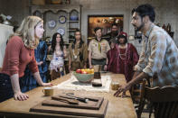 """This image released by CBS shows Rose McIver, foreground left, and Utkarsh Ambudkar in a scene from the comedy series """"Ghosts."""" (Bertrand Calmeau/CBS via AP)"""