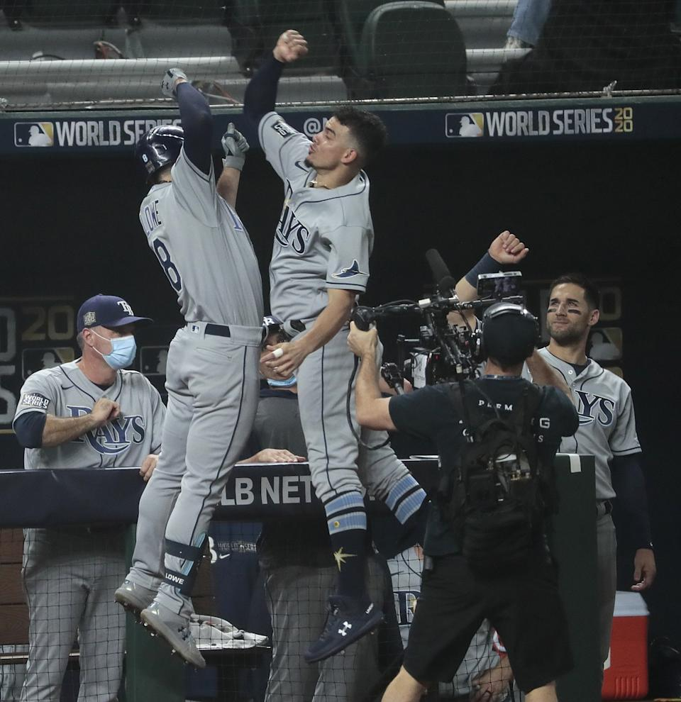 Tampa Bay Rays second baseman Brandon Lowe celebrates with teammate Willy Adames after hitting a home run.