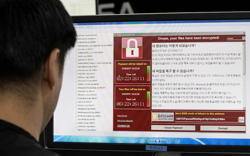 May 15, 2017 shows staff monitoring the spread of ransomware cyber-attacks at the Korea Internet and Security Agency (KISA) in Seoul - Credit: Yonhap/AFP