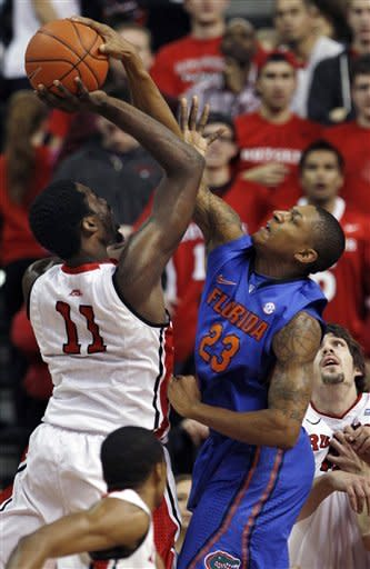Florida's Bradley Beal (23) blocks a shot by Rutgers' Dane Miller (11) during the first half of an NCAA college basketball game in Piscataway, N.J., Thursday, Dec. 29, 2011. (AP Photo/Mel Evans)