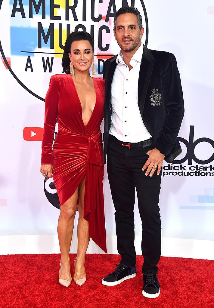 <p>Kyle Richards and Mauricio Umansky attend the 2018 American Music Awards at Microsoft Theater on Oct. 9, 2018, in Los Angeles. (Photo: Frazer Harrison/Getty Images) </p>