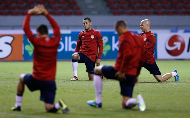 SAN JOSE, COSTA RICA - SEPTEMBER 05: Clint Dempsey and Michael Bradley of the United States stretch during the United States Training Session at Estadio Nacional on September 5, 2013 in San Jose, Costa Rica. (Photo by Kevin C. Cox/Getty Images)