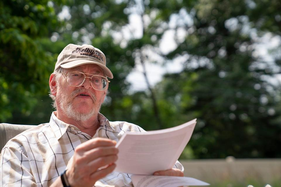 James Hanlon of Shelby Township, 71, explains his tax forms Wednesday, July 7, 2021. The couple has been waiting since March of 2020 for their income tax refund. James Hanlon is concerned he may have made a mistake with the Recovery Rebate Credit now when he used TurboTax.