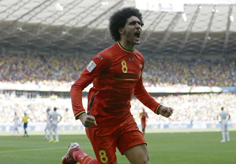 Belgium's Marouane Fellaini celebrates after scoring his side's first goal during the group H World Cup soccer match between Belgium and Algeria at the Mineirao Stadium in Belo Horizonte, Brazil, Tuesday, June 17, 2014