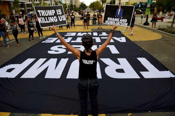PHOTO: Demonstrators rally to protest President Donald Trump's acceptance of the Republican National Convention nomination at Black Lives Matter plaza across from the White House, Aug. 27, 2020, in Washington. (Olivier Douliery/AFP via Getty Images)