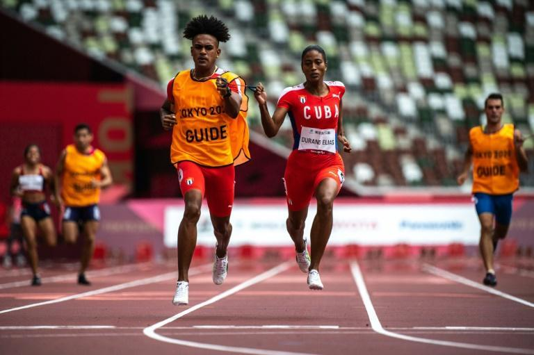 Cuba's Omara Durand is on dominant form, scooping her first Tokyo gold in the 400m, with the 100m and 200m finals in her sights (AFP/Philip FONG)