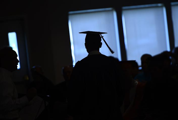 Graduated from high school in 2018 (Photo by Brendan SMIALOWSKI / AFP via Getty Images)