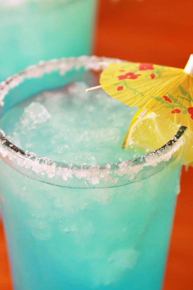 """<p>You're going to be crushing it after downing these blue crush margaritas.</p><p>Get the recipe from <a rel=""""nofollow"""" href=""""http://www.delish.com/cooking/recipe-ideas/recipes/a53910/blue-crush-margaritas-recipe/"""">Delish</a>.</p><p><strong><em>MAJOR BEACH VIBES: Cocktail Umbrellas, $7; <a rel=""""nofollow"""" href=""""http://buy.geni.us/Proxy.ashx?TSID=21947&GR_URL=https%3A%2F%2Fwww.amazon.com%2FCocktail-Parasols-Attached-Wooden-50-count%2Fdp%2FB00A1DWP18%2F%3Ftag%3Ddelish_auto-append-20%26ascsubtag%3Ddelish.article.53909"""">amazon.com</a>.</em></strong></p>"""
