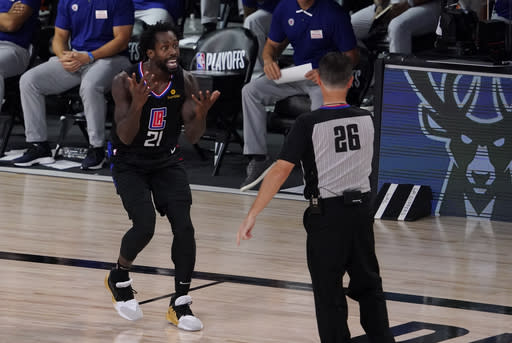 Los Angeles Clippers' Patrick Beverley (21) reacts to a call by referee Pat Fraher (26) during the second half of an NBA conference semifinal playoff basketball game against the Denver Nuggets Saturday, Sept. 5, 2020, in Lake Buena Vista, Fla. Beverley was ejected from the game. The Nuggets won 110-101. (AP Photo/Mark J. Terrill)