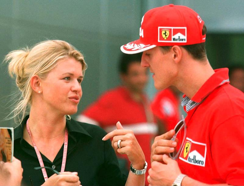 SEPANG, MALAYSIA - OCTOBER 16: FORMEL 1: GP VON MALAYSIA 1999 Sepang, 16.10.99, Michael SCHUMACHER/FERRARI mit seiner Frau CORINNA im Fahrrerlager. (Photo by Andreas Rentz/Bongarts/Getty Images)