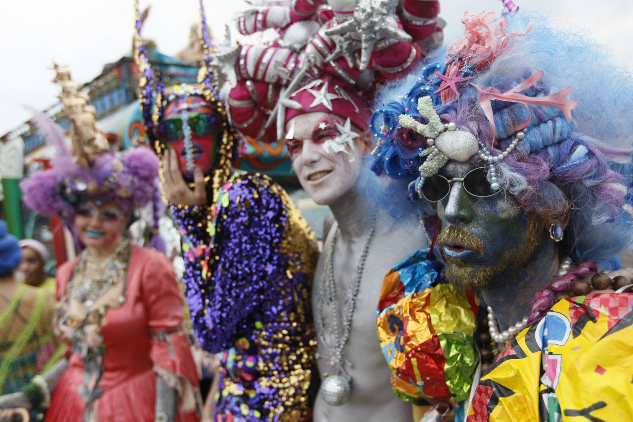 Hukkleferry, right, Syberfi, second from right, Machine Dazzle, second from left, and Kat Wise, of the group Mer Kin pose for photos during the 2011 Mermaid Parade, Saturday, June 18, 2011 in New York's Coney Island. (AP Photo/Mary Altaffer)