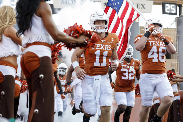 Texas Longhorns QB Sam Ehlinger and his brother, Jake Ehlinger, run onto the field before the game against the Louisiana Tech Bulldogs on Saturday. (Getty)