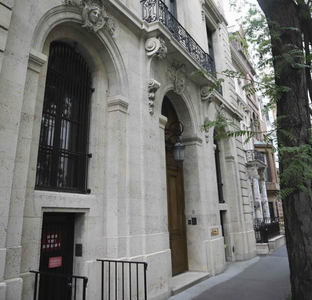 """This photo shows the Manhattan residence of Jeffrey Epstein, Monday July 8, 2019, in New York. Prosecutors said Monday, federal agents investigating wealthy sex offender Jeffrey Epstein found """"nude photographs of what appeared to be underage girls"""" while searching his Manhattan mansion. (AP Photo/Bebeto Matthews)"""