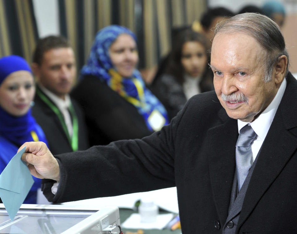 FILE -In this Thursday, Nov. 29, 2012, file photo, Algerian President Abdelaziz Bouteflika casts his ballot for local elections in Algiers. Former Algerian President Bouteflika, who fought for independence from France in the 1950s and 1960s and was ousted amid pro-democracy protests in 2019 after 20 years in power, has died at age 84, state television announced Friday, Sept. 17, 2021. (AP Photo/Anis Belghoul, File)