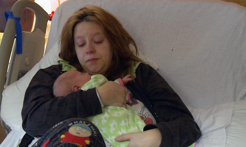 """This undated image from video released by Logo shows Genavieve Diggs with her baby who will be adopted by gay parents Mark Krieger and Paul Siebold in a scene from """"The Baby Wait."""" """"The Baby Wait"""" is a six-part documentary series on the Logo channel that focuses equal attention on agonizing post-birth waiting periods from the perspectives of both biological and adoptive parents. (AP Photo/Logo)"""