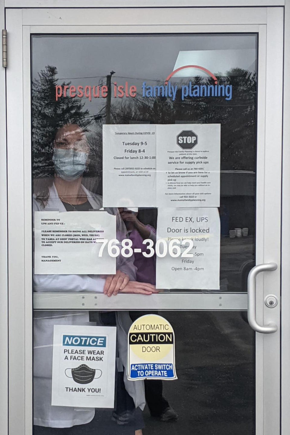 """This April 2021 photo provided by Christina Theriault, a nurse practitioner, shows her at the Maine Family Planning clinic in Presque Isle, Maine. Theriault says her abortion patients are grateful for the convenience and privacy of telemedicine. """"Some are in a bad relationship or victim of domestic violence,"""" she said. """"With telemedicine, they can do it without their partner knowing. There's a lot of relief from them."""" (Courtesy Christina Theriault via AP)"""