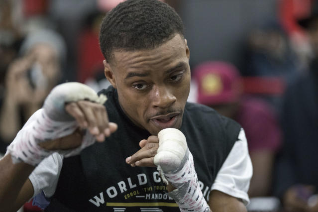 FILE - In this Jan. 17, 2018, file photo, Errol Spence Jr. warms up during a work out at Gleason's Gym in the Brooklyn borough of New York. The 2012 U.S. Olympian will defend his IBF crown back home in Texas on Saturday night, June 16, against Mexicos Carlos Ocampo in a mandatory defense between undefeated fighters. (AP Photo/Mary Altaffer, File)