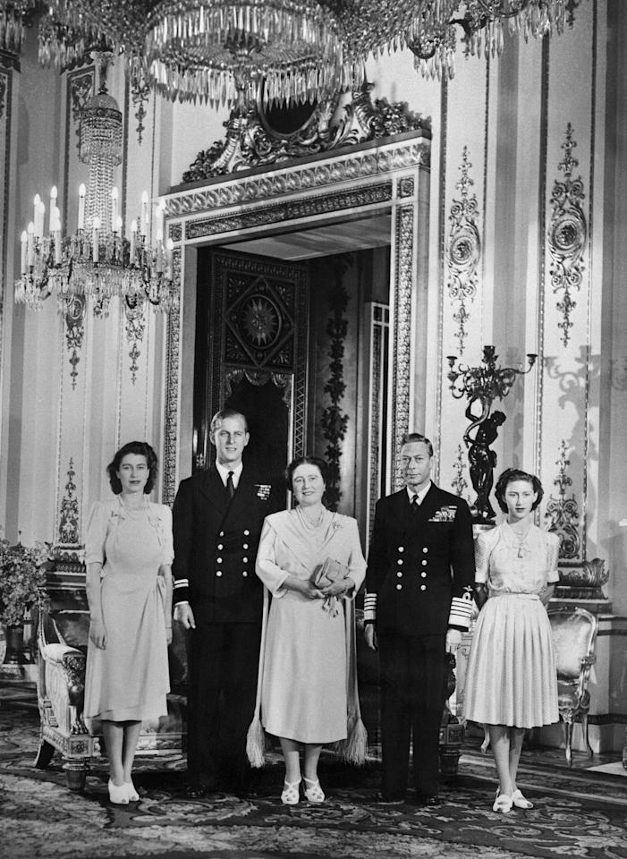 Elizabeth and Philip pose with King George VI, future Queen mother Elizabeth and Princess Margaret on the day the couple's engagement was officially announced at Buckingham Palace. (AFP via Getty Images)