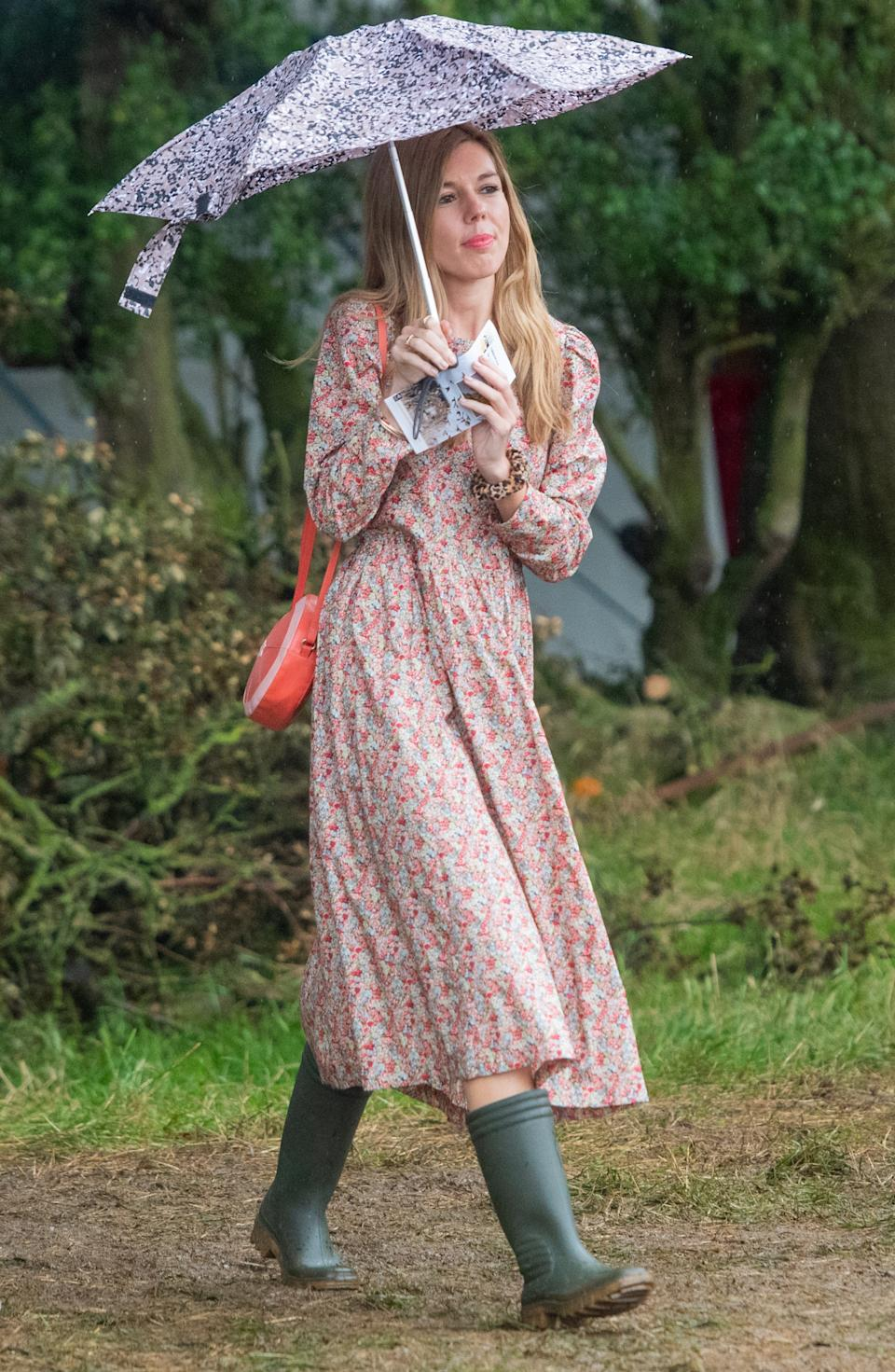 """To mark her first public speech as the UK's First Lady, Carrie Symonds went country-chic and wore a £255 sustainable eco-dress by designer Justine Tabak to Birdfair, an environmental conference at the Rutland Water Nature Reserve near Oakham. She styled the look with a pair of khaki wellington boots and a red handbag. <a href=""""https://fave.co/31GT3Zn"""" rel=""""nofollow noopener"""" target=""""_blank"""" data-ylk=""""slk:Shop now"""" class=""""link rapid-noclick-resp"""">Shop now</a>. <em>[Photo: Getty Images]</em>"""