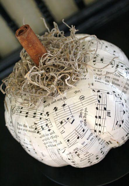 """<p>These creative pumpkins will flawlessly show off your personality. Mod Podge sheets of music or your favorite book pages. </p><p><em><strong>Get the tutorial from <a href=""""http://adiamondinthestuff.com/2011/09/decoupaged-pumpkins.html"""" rel=""""nofollow noopener"""" target=""""_blank"""" data-ylk=""""slk:A Diamond in the Stuff"""" class=""""link rapid-noclick-resp"""">A Diamond in the Stuff</a>.</strong></em></p>"""
