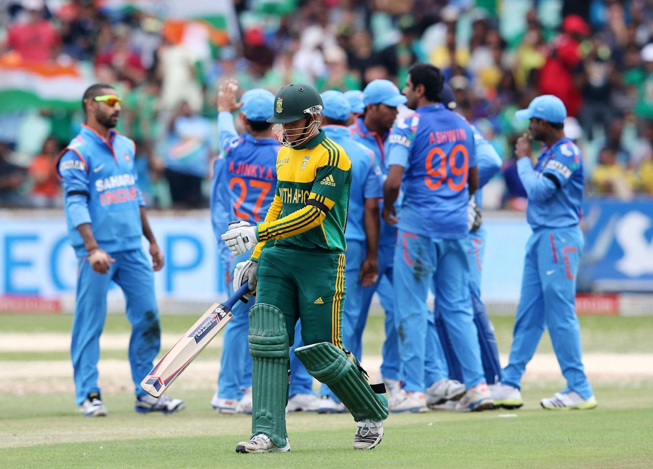 India's cricketers celebrate the wicket of South Africa's Quinton de Kock during the One day International (ODI) Cricket match between India and South Africa at SAHARA Stadium Kingsmead in Durban on December 8, 2013. AFP PHOTO / STRINGER