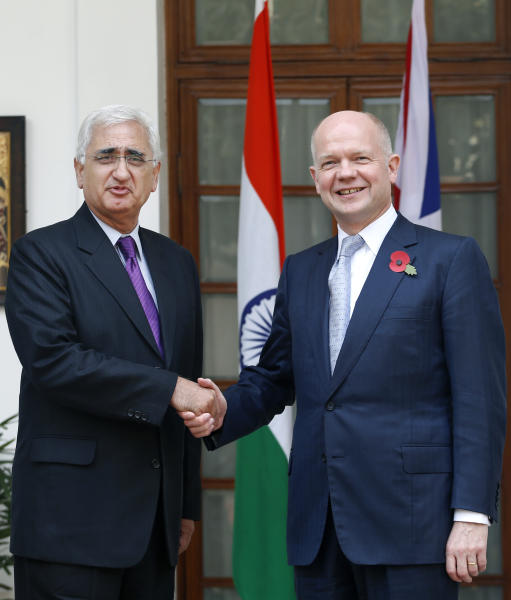 Indian Foreign Minister Salman Khurshid, left, poses for the media with British Foreign Secretary William Hague, before a meeting in New Delhi, India, Thursday, Nov. 8, 2012. Hague is meeting with top officials in the Indian capital to discuss ways to increase trade and investment and to tackle other issues, including terrorism, cyber security and defense. (AP Photo/Saurabh Das)