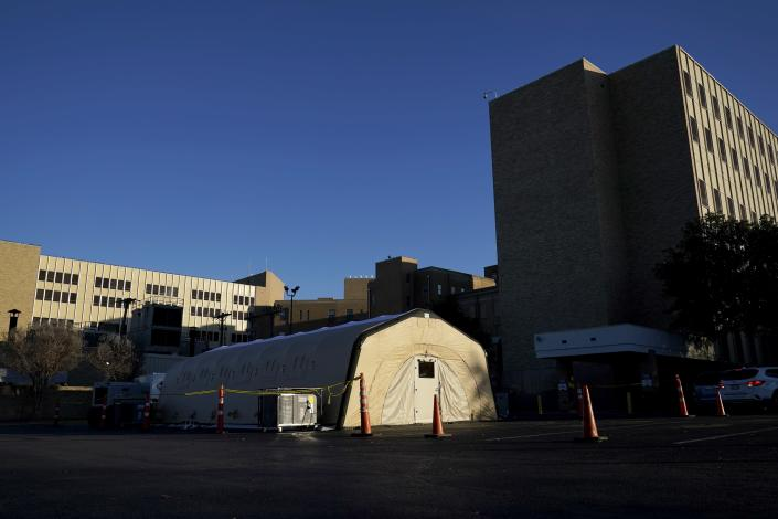 A portable, overflow, intensive care unit, that is currently not being used, is seen located behind Hendrick Medical Center on Wednesday, Dec. 16, 2020, in Abilene, Texas. (AP Photo/Tony Gutierrez)