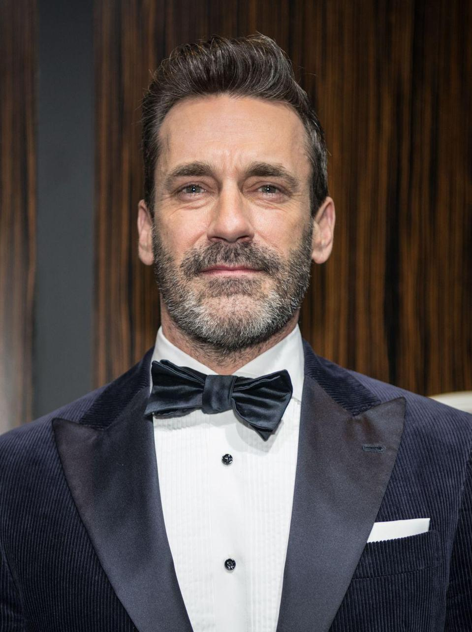 <p>The actor still looks dapper after letting the hair at his temples and beard go gray. Here he is at a 2019 Oscars viewing party. </p>